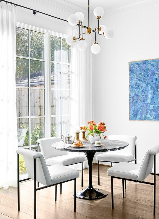 Blue Abstract Art In Black And White Dining Room