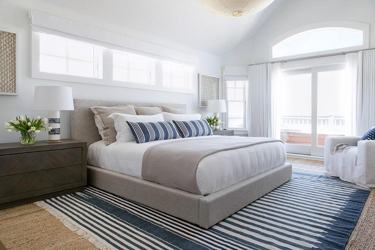 Dove Gray Linen Platform Bed With Blue Striped Fringe Rug