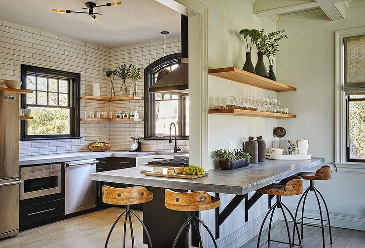 Concrete Kitchen Peninsula Countertop With Iron And Wood Swivel Stools