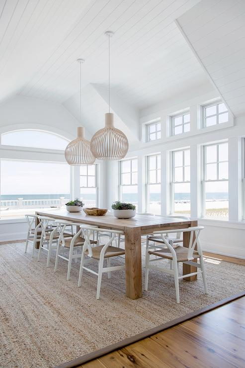 Long Solid Wood Dining Table With White Wishbone Chairs