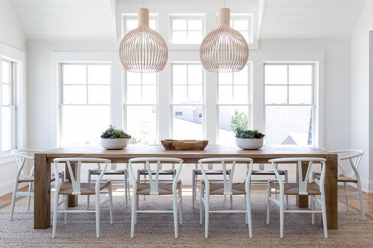 white wood chairs at caramel stained oak dining table - Long Wood Dining Table