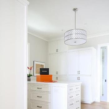 White Walk In Closet With Orange Hermes Boxes
