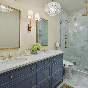 Blue Bath Vanity Drawers With Antique Brass Knobs