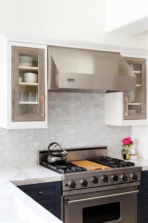 Viking Hood And Range With Oval Marble Tiles Transitional Kitchen