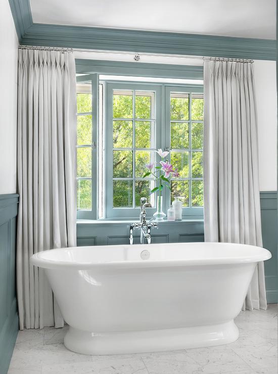 window designs casements more hgtv.htm roll top soaking bathtub under blue casement windows  roll top soaking bathtub under blue