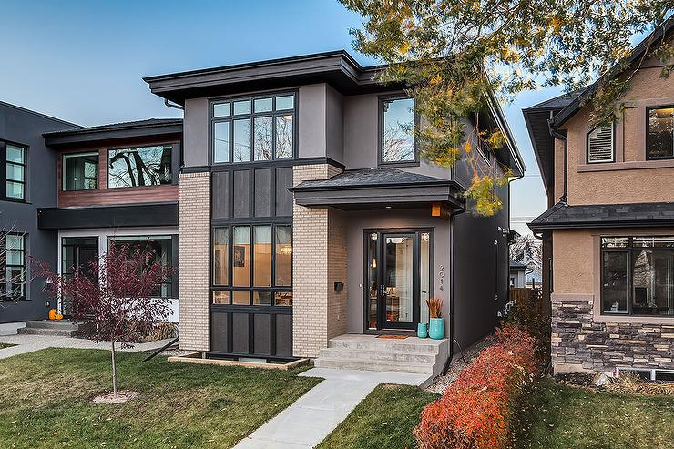 Gray Stucco Beige Stone 2 Story House