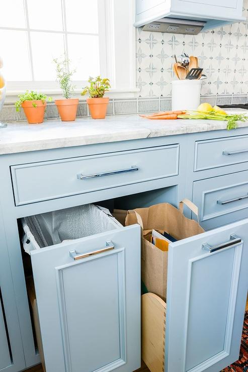 blue pull out cabinets with garbage can and recycling bag