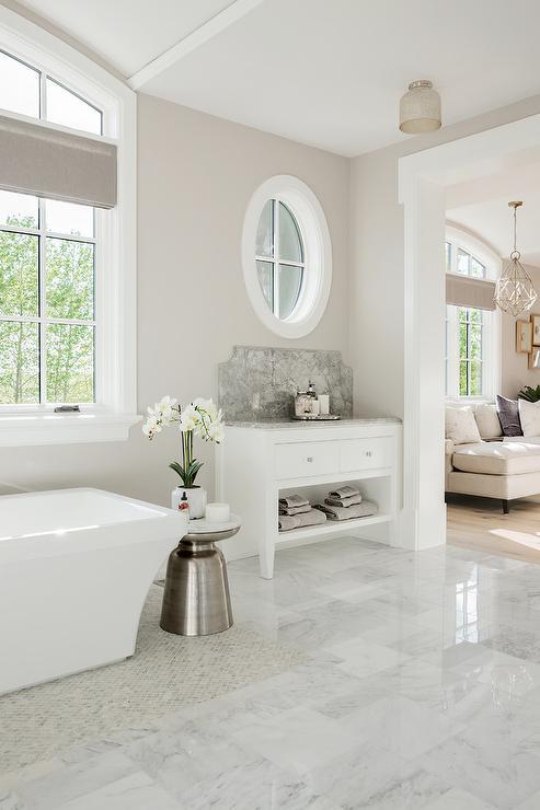 Silver Side Table With Rectangular Bathtub Transitional Bathroom