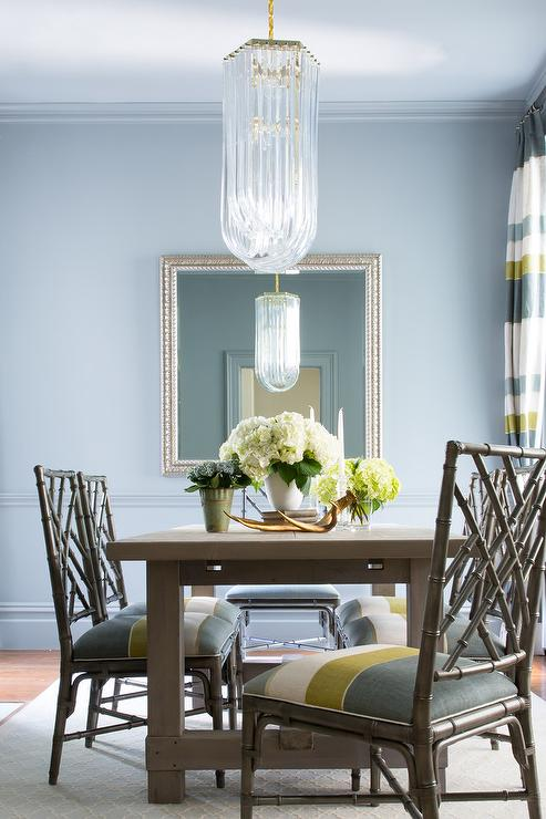 Stunning blue and green dining room is illuminated by a long crystal  chandelier hung from a pale blue ceiling over a gray wood dining table  surrounded by  Dining Room design  decor  photos  pictures  ideas  inspiration  . Green Dining Rooms. Home Design Ideas