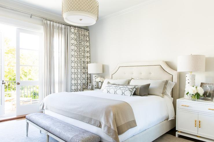 beige tufted headboard with white and gold cabinets - transitional