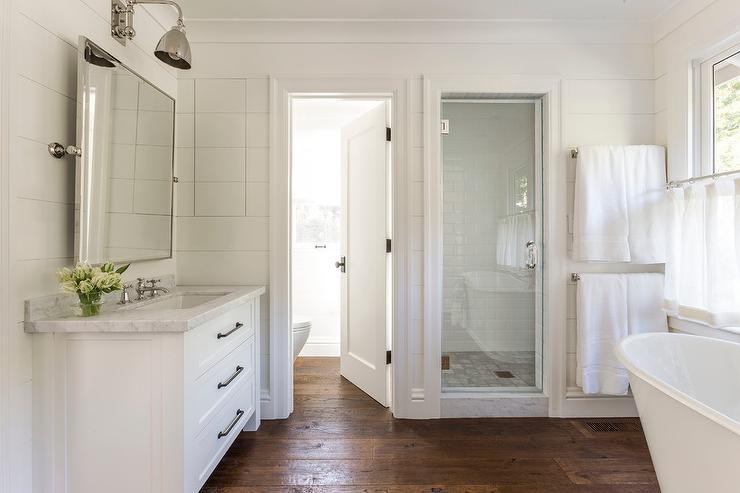 Stacked Towel Rails Next To Bathtub