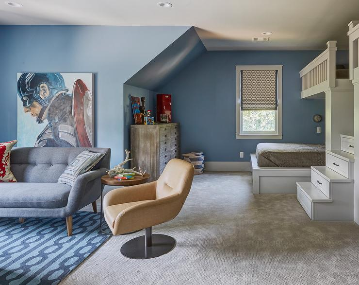 Large Blue Shared Boys Bedroom Features A Gorgeous Lounge Area Furnished With Mid Century Modern Sofa Placed On Trellis Rug Beside Round