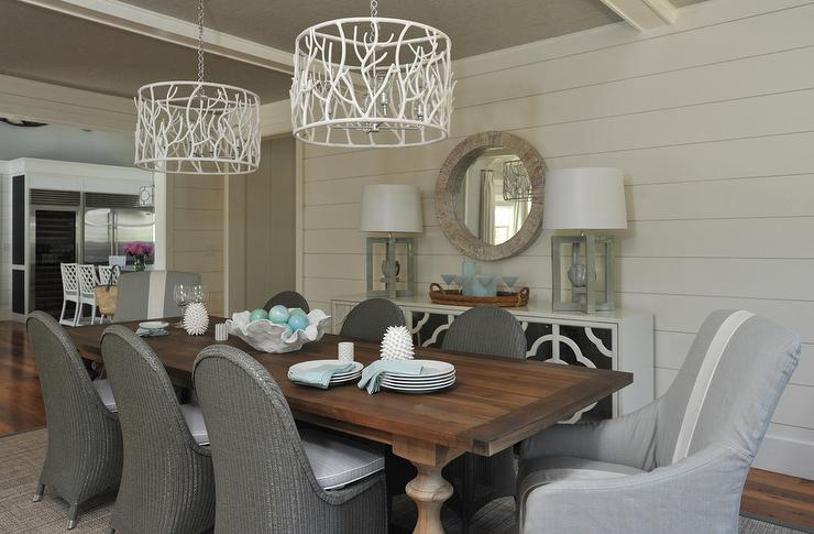 Gray Wicker Chairs At Wood Balustrade Dining Table