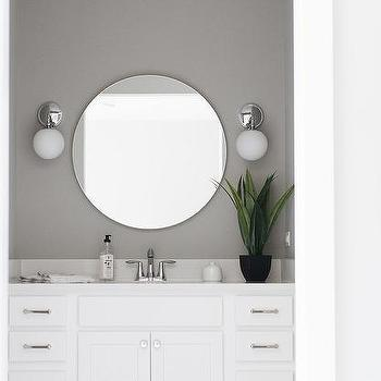 'Gray Powder Room Wall with Round Silver Mirror' from the web at 'https://cdn.decorpad.com/photos/2017/10/23/m_white-washstand-with-shaker-drawers-and-cabinets.jpg'