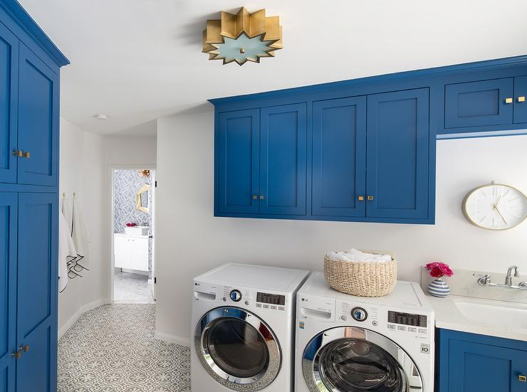 Blue Laundry Room Cabinets With White Countertops