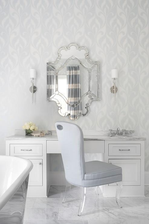 Gray Bedroom With Lucite Makeup Vanity And Silver Chair