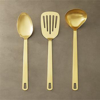 'view full size' from the web at 'https://cdn.decorpad.com/photos/2017/10/25/m_cb2-brushed-gold-kitchen-utensils.jpg'