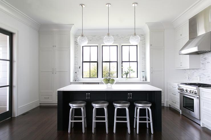 'view full size' from the web at 'https://cdn.decorpad.com/photos/2017/10/30/black-island-with-storage-cabinets.jpg'