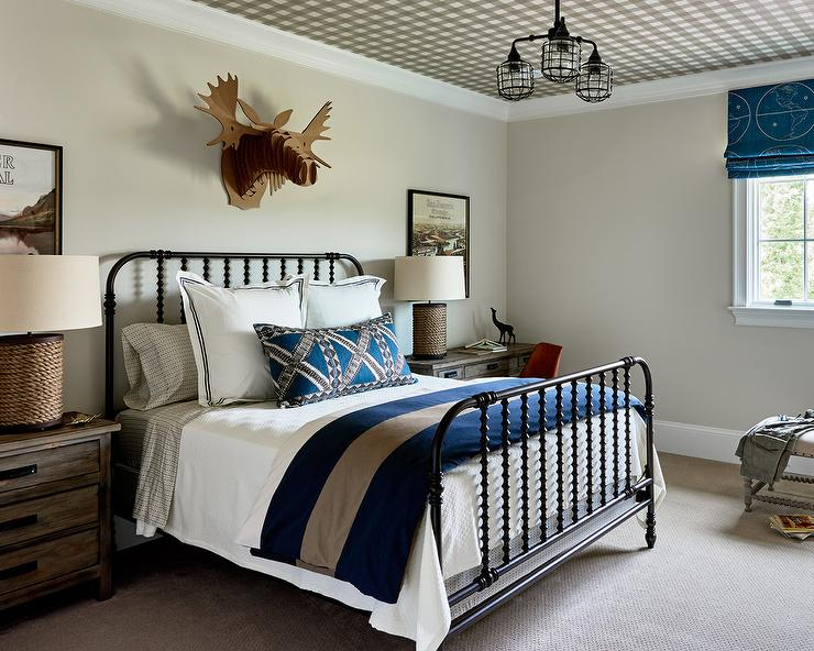 Black Spindle Bed With White And Blue Bedding