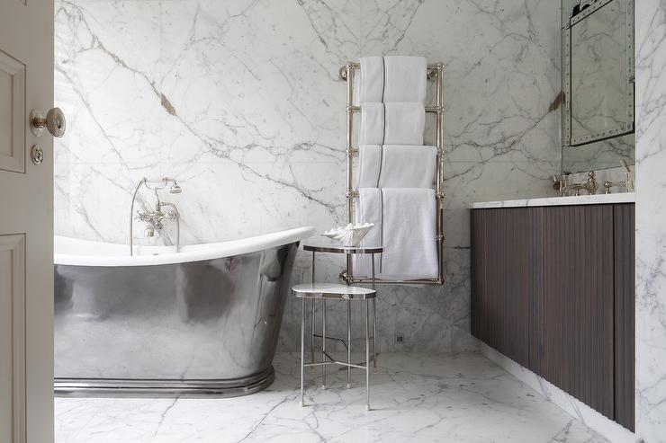 'view full size' from the web at 'https://cdn.decorpad.com/photos/2017/10/30/cast-iron-bathtub-with-wall-mount-towel-warmer.jpg'