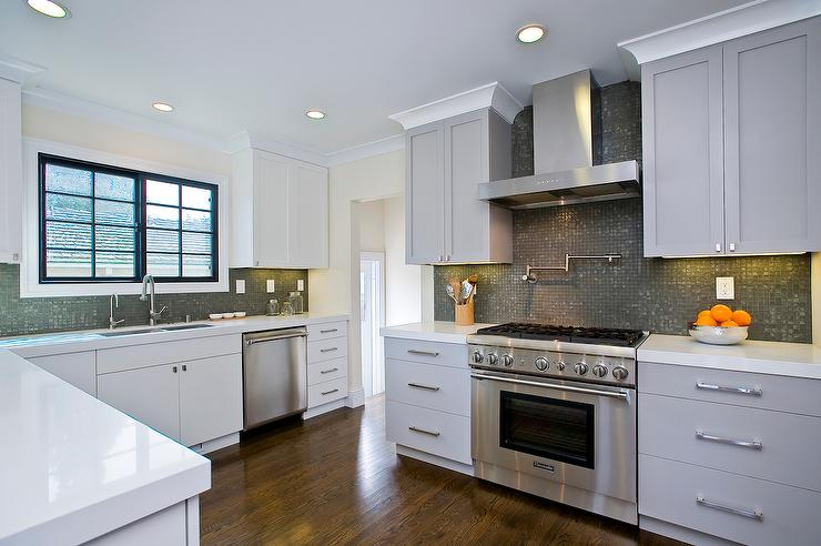 'view full size' from the web at 'https://cdn.decorpad.com/photos/2017/10/30/concrete-gray-cabinets-with-charcoal-gray-glass-grid-tiles.jpg'