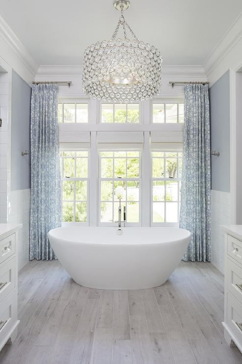 Large Crystal Drum Pendant Light Over Oval Bathtub Transitional Bathroom
