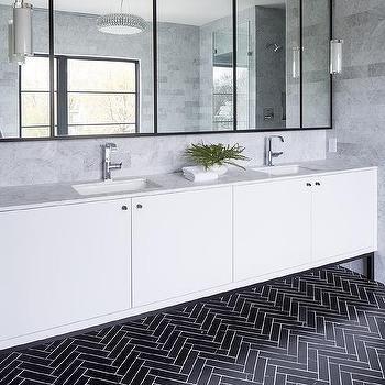 'Black Herringbone Tiles with White Flat Front Vanity Cabinets' from the web at 'https://cdn.decorpad.com/photos/2017/10/30/m_black-herringbone-tile-floor.jpg'
