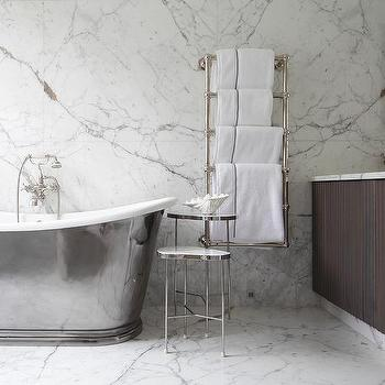 'Brown Reeded Washstand with Venetian Mirrors' from the web at 'https://cdn.decorpad.com/photos/2017/10/30/m_cast-iron-bathtub-with-wall-mount-towel-warmer.jpg'
