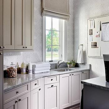 'Light Gray Laundry Cabinets with Gray Granite countertops' from the web at 'https://cdn.decorpad.com/photos/2017/10/30/m_gray-laundry-cabinets-with-gray-granite-countertops.jpg'