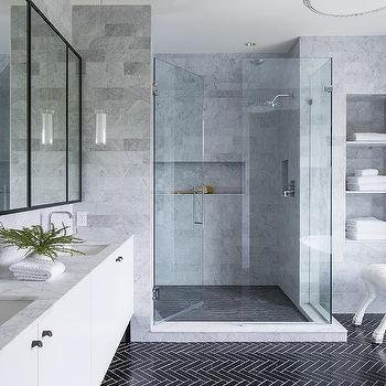 'Black Herringbone Bath Floor Tiles with White Grout' from the web at 'https://cdn.decorpad.com/photos/2017/10/30/m_gray-marble-tiled-bath-towel-niche-shelves.jpg'