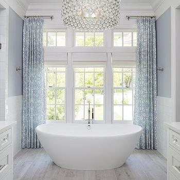 'Large Crystal Drum Pendant Light Over Oval Bathtub' from the web at 'https://cdn.decorpad.com/photos/2017/10/30/m_gray-wash-wood-like-bathroom-floor-tiles.jpg'