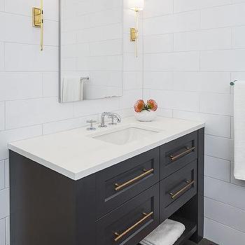 'Black Washstand on Black Hexagon Tiles' from the web at 'https://cdn.decorpad.com/photos/2017/10/30/m_large-white-subway-tiles-on-bathroom-walls.jpg'