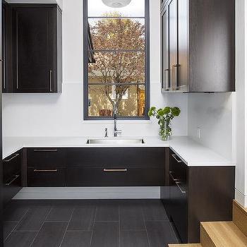 Sunken Modern Mudroom With Espresso Stained Oak Cabinets