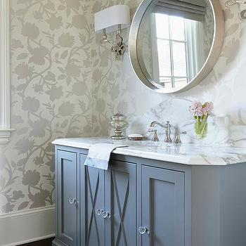'Blue Powder Room Vanity with Blue X Trim Moldings' from the web at 'https://cdn.decorpad.com/photos/2017/10/30/m_powder-room-blue-x-trim-moldings-on-blue-washstand.jpg'