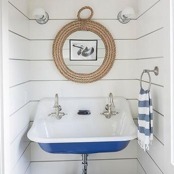 'Blue Trough Sink with Round Rope Mirror' from the web at 'https://cdn.decorpad.com/photos/2017/10/30/m_rope-mirror-with-blue-vintage-sink.jpg'