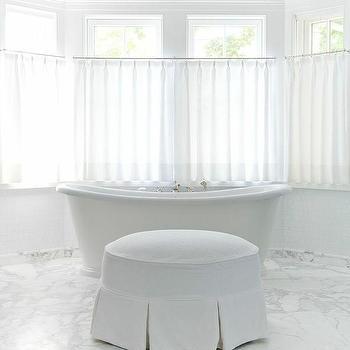 'Bay Window Roll Top Bathtub' from the web at 'https://cdn.decorpad.com/photos/2017/10/30/m_round-white-skirted-bathroom-ottoman.jpg'