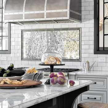 Mirrored Tiles Behind Stove Design Ideas