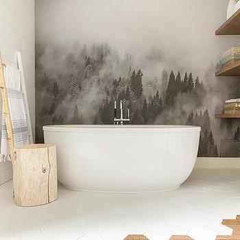 'Black and White Mountains Mural Behind Oval Bathtub' from the web at 'https://cdn.decorpad.com/photos/2017/10/30/m_wall-mural-behind-freestanding-bathtub.jpg'