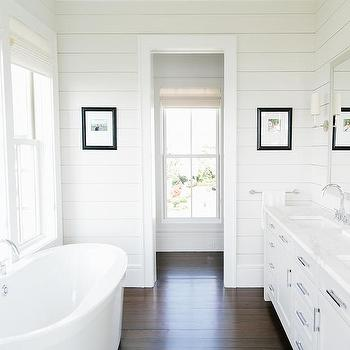 'White Dual Vanity with Shiplap Walls' from the web at 'https://cdn.decorpad.com/photos/2017/10/30/m_white-bathroom-cabinets-with-dark-wood-floors.jpg'