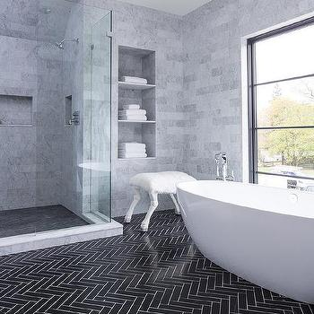 'Gray Marble Tiled Niche Towel Shelves' from the web at 'https://cdn.decorpad.com/photos/2017/10/30/m_white-grout-with-black-herringbone-bathroom-floor-tiles.jpg'