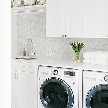 'Mosaic Marble Laundry Room Wall Tiles with Shelf' from the web at 'https://cdn.decorpad.com/photos/2017/10/30/m_white-laundry-room-ideas.jpg'