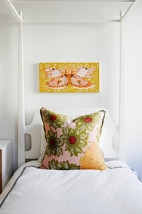 Orange and pink butterfly wall art hangs over a white canopy girls bed accented with an orange pink and green accent pillow. & Twin White Canopy Bed with Pink and Green Pillow - Transitional ...
