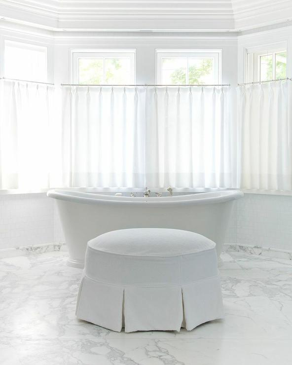'view full size' from the web at 'https://cdn.decorpad.com/photos/2017/10/30/round-white-skirted-bathroom-ottoman.jpg'