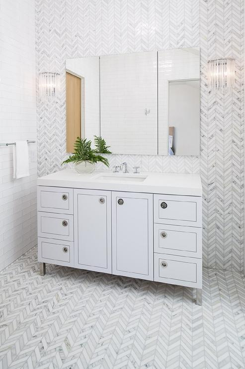 'view full size' from the web at 'https://cdn.decorpad.com/photos/2017/10/30/white-and-gray-marble-herringboen-tiles-on-bathroom-walls-and-floor.jpg'