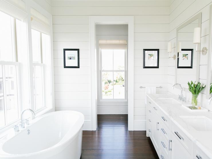 'view full size' from the web at 'https://cdn.decorpad.com/photos/2017/10/30/white-bathroom-cabinets-with-dark-wood-floors.jpg'