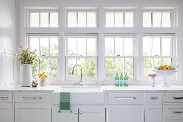 Band Of Windows Over Farmhouse Sink With Gooseneck Faucet