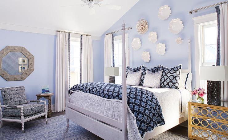 Blue Cottage Bedroom Is Accented With Decorative Plates Hung From A Blue  Wall Above A Light Gray Oak 4 Poster Bed Dressed In White And Blue Bedding.