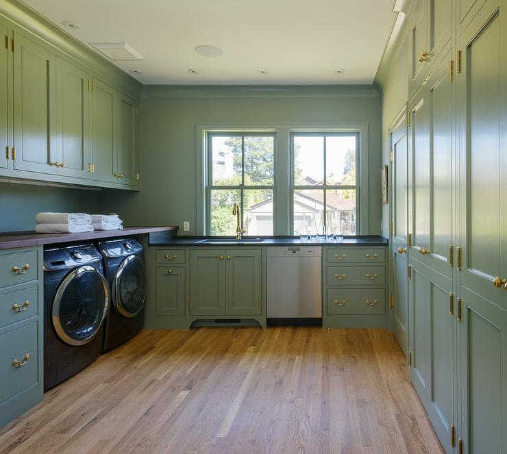 Green Gray Laundry Room Cabinets With Vintage Brass Pulls