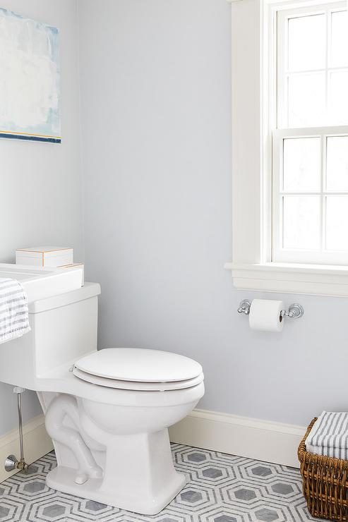 Baby Blue Bathroom Tile Light blue walls accent a bathroom clad in white and gray hexagon floor  tiles fixed framing a white porcelain toilet mounted beneath a blue  abstract art ...