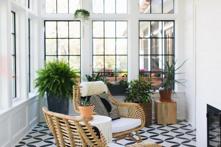 Sunroom Windows Accented With Black Panels Complement Black And White  Geometric Floor Tiles Positioned Beneath A White And Gold Stool Accent  Table Flanked ...